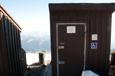 """Solar composting toilet. Note that although this is classified a """"strenous"""" hike by any guidebook, climbing 4,500ft in 4.2 miles, this toilet is ADA accessible. But only if you can climb up through the top half of the door. I guess if you're disabled and do this hike, climbing through the top half of the door is the least of the obstacles you've overcome."""