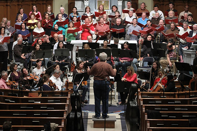 J. Wayne Baughman, foreground center, works with the orchestra and choir during a rehearsal for the Dec. 1 Christmas Gala and Holiday Pops Concert.