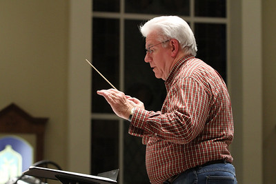 J. Wayne Baughman, founder, music director and conductor of the Johns Creek Symphony Orchestra, leads the orchestra during a Nov. 29 rehearsal for the orchestra's Dec. 1 Christmas Gala and Holiday Pops Concert. Baughman also serves as the music director at St. Benedict Church, Johns Creek, site of the concert.