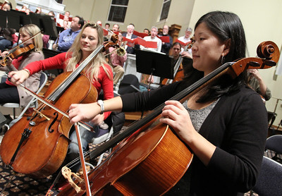 (R-l) Meghan McGuire and Charae Krueger rehearse with the Johns Creek Symphony Orchestra.