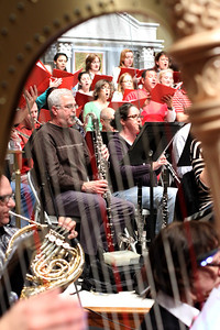 The orchestra and chorus rehearse together for the seventh annual Christmas Gala and Holiday Pops Concert.