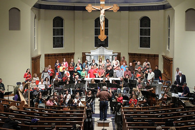 J. Wayne Baughman, foreground center, founder, music director and conductor of the Johns Creek Symphony Orchestra, addresses the orchestra and choir during a rehearsal for the Dec. 1 Christmas Gala and Holiday Pops Concert. The seventh annual concert was held at St. Benedict Church, Johns Creek, where Baughman also serves as the music director for the parish.