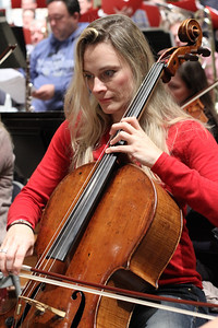 Orchestra member Charae Krueger plays the cello.