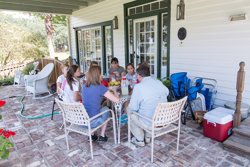 Volunteer Students from Ashley Hall enjoy lunch after working on the Schoolhouse Museum