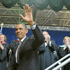 Globe/Roger Nomer<br /> President Barack Obama waves farewell to Joplin High School graduates following his address at graduation on Monday.