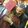 Globe/Roger Nomer<br /> President Barack Obama embraces a graduate before Joplin High School graduation on Monday.