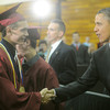 Globe/Roger Nomer<br /> Derek Carter shakes hands with President Barack Obama before Joplin High School graduation on Monday.