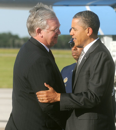Globe/Roger Nomer<br /> Gov. Jay Nixon greets President Barack Obama as he exits Airforce One at the Joplin Regional Airport on Monday.