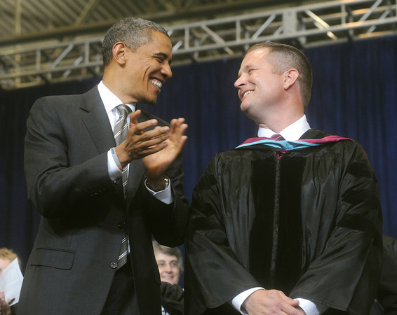Globe/Roger Nomer<br /> President Barack Obama applauds Joplin Superintendent CJ Huff as Huff is recognized for his efforts following the May 22 tornado at Joplin High School's graduation on Monday.