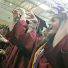 Globe/Roger Nomer<br /> Members of the 2012 Joplin High School graduating class give one last senior cheer during graduation on Monday.