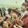 Globe/Roger Nomer<br /> Quinton Anderson applauds President Barack Obama following the president's address on Monday at Joplin High School's graduation.