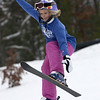 Record-Eagle/Garret Leiva<br /> Bailey Verslvis, 9, attempts to grab a ski as she performs an aerial trick at the Jr. Air Affair skills clinic and competition Saturday at Mt. Holiday.