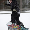 Record-Eagle/Garret Leiva<br /> An unidentified snowboarder launches off a ramp at the Jr. Air Affair skills clinic and competition Saturday at Mt. Holiday.
