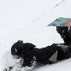 Record-Eagle/Garret Leiva<br /> A snowboarder plants their face in the snow after wiping out at the Jr. Air Affair skills clinic and competition Saturday at Mt. Holiday.