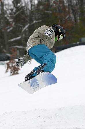 Record-Eagle/Garret Leiva<br /> Michael Murfield, 10, performs an aerial trick on his snowboard at the Jr. Air Affair skills clinic and competition Saturday at Mt. Holiday.