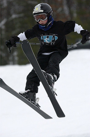 Record-Eagle/Garret Leiva<br /> Andrew Bliss, 6, leans back in midair as he gravitates over the slope at the Jr. Air Affair skills clinic and competition Saturday at Mt. Holiday.