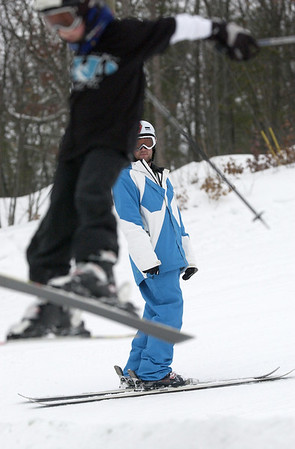 Record-Eagle/Garret Leiva<br /> Instructor Mark Goethel watches Andrew Bliss, 6, as he flies off a ramp at the Jr. Air Affair skills clinic and competition Saturday at Mt. Holiday.