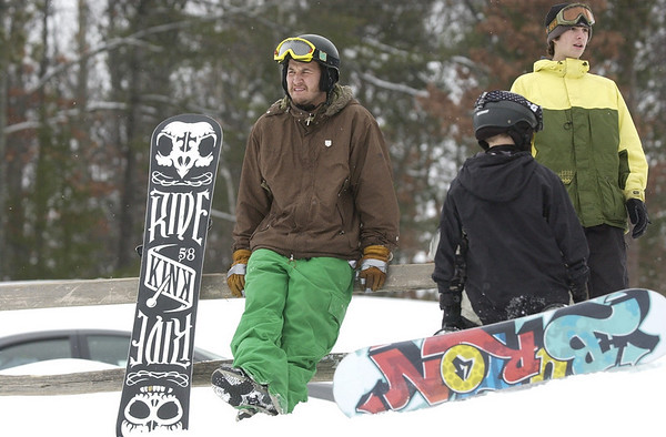 Record-Eagle/Garret Leiva<br /> Calvin Remington watches participants in the Jr. Air Affair Saturday at Mt. Holiday. Remington, Jonah Coski and Mark Goethel worked with young skiers and snowboarders on their jumping skills before an air competition on the slopes.