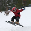 Record-Eagle/Garret Leiva<br /> Charlie Black, 5, of Traverse City, spreads his arms and flies as he catches air at the Jr. Air Affair skills clinic and competition Saturday at Mt. Holiday.
