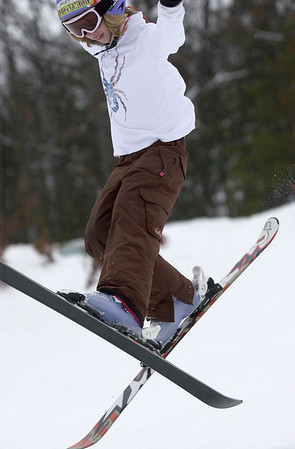 Record-Eagle/Garret Leiva<br /> Carley Laird, 10, of Traverse City, crosses her skis as she performs an aerial trick at the Jr. Air Affair skills clinic and competition Saturday at Mt. Holiday.