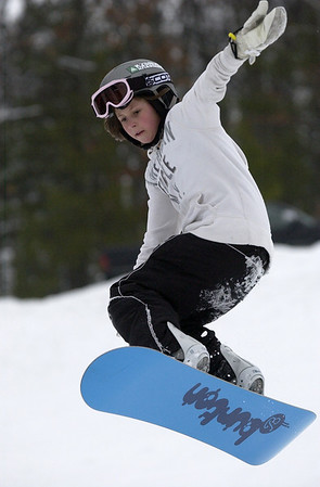 Record-Eagle/Garret Leiva<br /> Julia Vannatter, 10, flies off a ramp at the Jr. Air Affair skills clinic and competition Saturday at Mt. Holiday.
