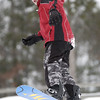 Record-Eagle/Garret Leiva<br /> Fletcher Reyher, 10, of Traverse City points his snowboard over the edge of a ramp at the Jr. Air Affair skills clinic and competition Saturday at Mt. Holiday.