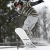 Record-Eagle/Garret Leiva<br /> Keelin Lundwall, 10, of Traverse City, launches his snowboard off a ramp at the Jr. Air Affair skills clinic and competition Saturday at Mt. Holiday in Traverse City. Skiers and snowboarders, ages 5 to 10 years old, worked on their jumping skills with instructors. After taking part in a morning clinic, skiers and snowboarders tried out their new aerial skills on two ramps.