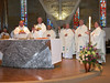 The jubilarians stand behind the altar as the primary con-celebrants.