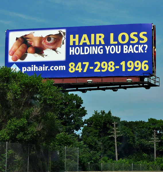 Not only is this billboard creepy, it also has a mild goatse-esque style (yuck).  GAH.
