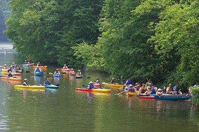 "IMGP4219: Saturday, June 2nd, 2007: Paddlers line up above the Dam in the Auburn Desilting Basin, waiting to ""portage"" (carry) their boats around the dam."