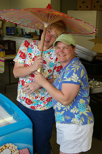 IMGP1173: Friday, June 1st, 2007: Sandy Hess & Gloria Ebling take a brief moment to have fun between customers at the Pre-Sojourn festivities.