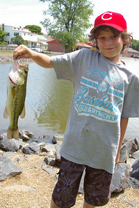 Wednesday, June 20th, 2007: Bailey Sophy, age 9, Schuylkill Haven proudly shows a smallmouth bass he caught at Stoyer's Dam during a picnic with the Jerusalem Child Care Summer Program.  Bailey is the grandson of Sally Morgan and the great-grandson of Mal Weaver Bartram.