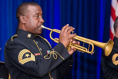 """U.S. Soldiers with the U.S. Army Band """"Pershing's Own"""" perform during the Medal of Honor reception for then- 1st Lt. Garlin M. Conner at the Sheraton Pentagon City Hotel, in Arlington, Va., June 25, 2018. Conner will be posthumously awarded the Medal of Honor June 26, 2018, for actions while serving as an intelligence officer with Headquarters and Headquarters Company, 3rd Battalion, 7th Infantry Regiment, 3rd Infantry Division, during World War II on Jan. 24, 1945. (U.S. Army photo by Spc. Anna Pol)"""