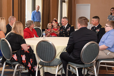 The Director of Army Staff, U.S. Army Lt. Gen. Gary Cheek meets with the Conner family during the Medal of Honor reception for then- 1st Lt. Garlin M. Conner at the Sheraton Pentagon City Hotel, in Arlington, Va., June 25, 2018. Pauline Conner will be posthumously awarded the Medal of Honor June 26, 2018, for actions while serving as an intelligence officer with Headquarters and Headquarters Company, 3rd Battalion, 7th Infantry Regiment, 3rd Infantry Division, during World War II on Jan. 24, 1945. (U.S. Army photo by Spc. Anna Pol)