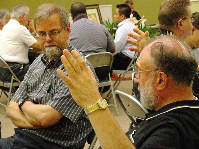 Fr. Claudio listens to Fr. Tony Russo.