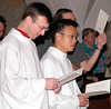Fraters Greg Schill and Duy Nguyen at their installation as acolytes.