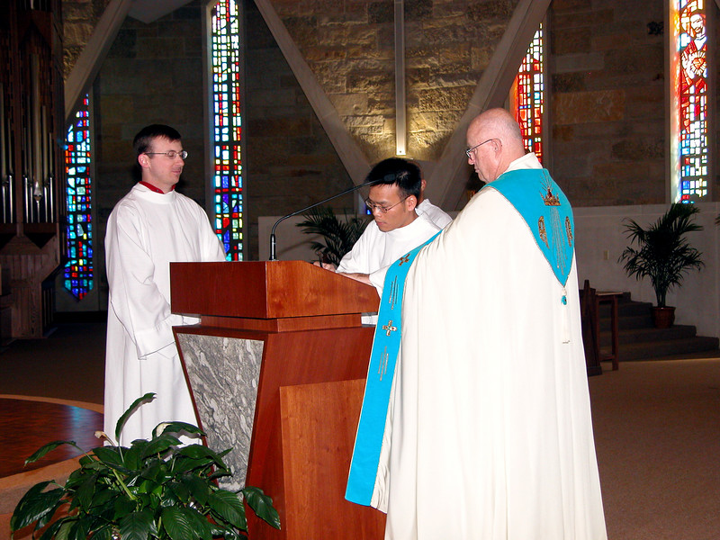 Signing the documents during their acolyte ceremony.