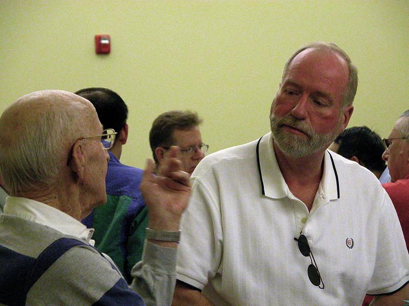 Fr. Ed Kilianski listens to Br. Jim Willis.