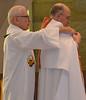 Fr. John helps Fr. Steve