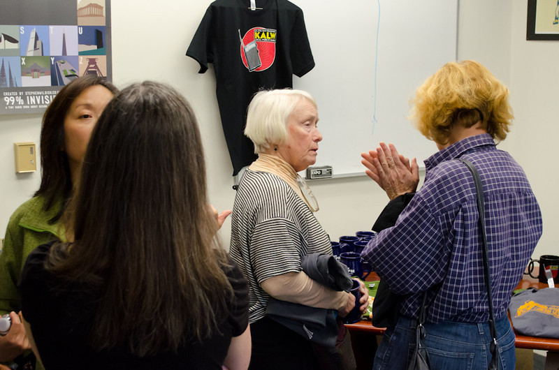 Donors and volunteers in promotional gear room. Donor Event, KALW studios, 500 Mansell St., San Francisco, California.