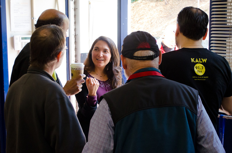Rose Aguilar with donors and volunteers near entrance doors. KALW Donor Event, KALW studios, 500 Mansell St., San Francisco, California.