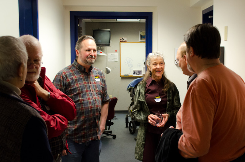 Donors talking in hallway. KALW Donor Event, KALW studios, 500 Mansell St., San Francisco, California.