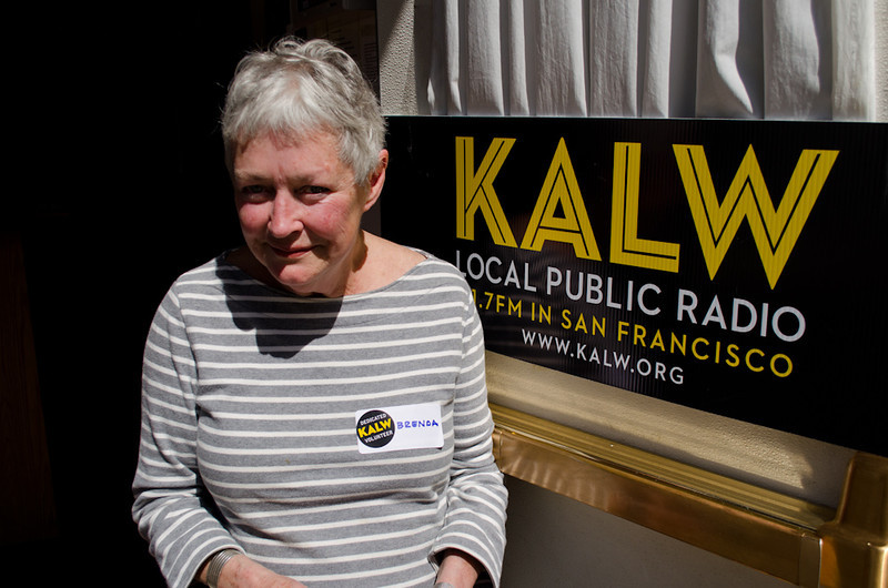 Brenda Kett (volunteer) with KALW sign. KALW Donor Event, KALW studios, 500 Mansell St., San Francisco, California.
