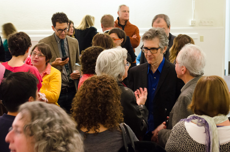 Ira Glass talking donor in group. KALW Ira Glass donor  reception. Kanbar Performing Arts Center, 44 Page St., San Francisco, California.