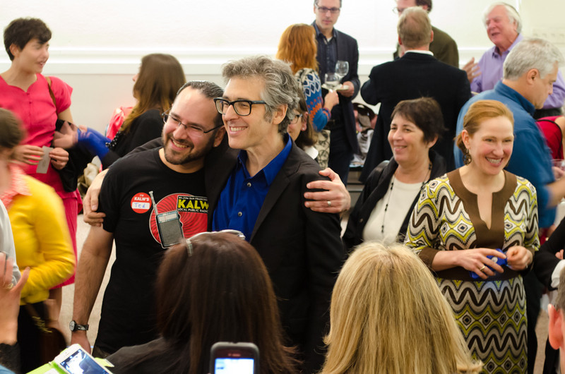 Ira Glass with volunteer Ted during photo op. KALW Ira Glass donor  reception. Kanbar Performing Arts Center, 44 Page St., San Francisco, California.