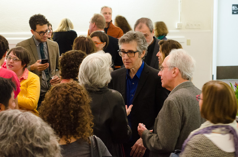 Ira Glass talking with donor in group. KALW Ira Glass donor  reception. Kanbar Performing Arts Center, 44 Page St., San Francisco, California.