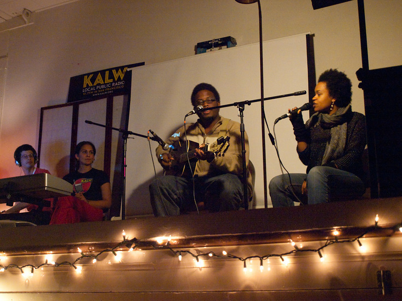 Quinn Deveaux (guitar) and Meklit Hadero perform on stage, with Seth Samuel and Martina Castro of the production team. Crosscurrents Live, KALW Mission Arts and Performance Project, MAPP, December 2011. The Polish Club, 3040-22nd St., Mission district, San Francisco, California.
