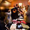 Just Causes table with t-shirt and attendees. KALW Presents Tavis Smiley & Cornel West, Paramount Theatre, 2025 Broadway, Oakland, California.