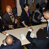 Book signing table. KALW Presents Tavis Smiley & Cornel West, Paramount Theatre, 2025 Broadway, Oakland, California.
