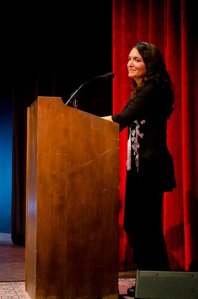 Rose Aguilar at podium. KALW Presents Tavis Smiley & Cornel West, Paramount Theatre, 2025 Broadway, Oakland, California.